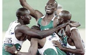 Nigeria's victorious quartet - Bada, Chukwu and Monye mobbing Enefiok after this great anchor leg run!