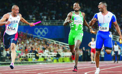 Maurice Greene, Deji Aliu and Mark Lewis-Francis as they cross the finish line in the men's 4x100m at Athens '04