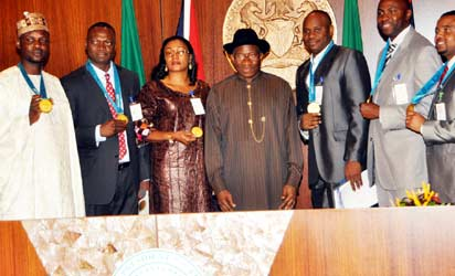 On July 24th 2013, President Goodluck honoured the 6 men who won the GOLD for Nigeria, awarding each of them N5 million - Sunbo, Sunday Bada's wife, stood in for him (L-R Fidelis Gadzama, Jude Monye, Sunbo Bada, President Goodluck Jonathan, Enefiok Udo-Obong, Nduka Awazie)