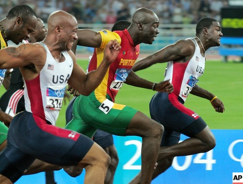 Francis Obikwelu (centre) wins Olympic 100m Silver for Portugal behind USA's Justin Gatlin and ahead of Maurice Greene. The favourite at the time Asafa Powell (with head dropped) finished in 5th!
