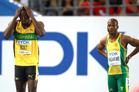 Simon Magakwe lining up against Usain Bolt at the 2011 World Championships. Magakwe is the fastest African so far in 2014, joining the sub-10 sprinters club with a new PB of 9.98 seconds