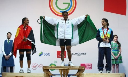 (L-R) Silver medalist Dika Toua of Papa New Guinea, Gold medalist Chika Amalaha of Nigeria and Bronze medalist Santoshi Matsu of India after the Women's 53kg Group A Weightlifting  (Photo by Julian Finney/Getty Images)