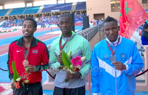 Hua Wilfried Koffi emerged double sprint champion at the 2014 African Championships in Marrakech. He won the 200m ahead of Isaac Makwala of Botswana (R) and Kenya's Carvin Nkata (L).
