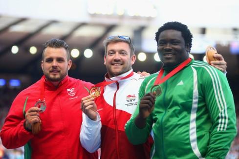 Silver: Aled Davies (Wales), GOLD; Dan Greaves (England), Bronze: Richard Okigbazi (Nigeria) (Photo Credit: Julian Finney/Getty)