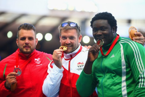 (L-R) Silver medallist Aled Davies of Wales, GOLD medallist Dan Greaves of England and Bronze medallist Richard Okigbazi of Nigeria for F42/44 Discus at 2014 Commonwealth Games! (Photo Credit: Julian Finney/Getty)