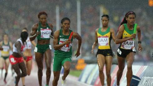 Folashade Abugan, 400m Nigerian Champion, after receiving the baton from Ada Benjamin  for the last leg of the women's 4x400m at Hampden Park in Glasgow at the 2014 C'wealth Games.  Jamaica won the GOLD, with Nigeria getting the Silver and England the Bronze!  (Photo Credit: AP Photo/ Scott Heppell)