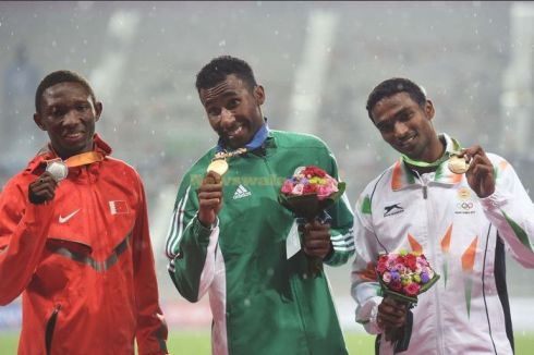 Abbas Abubakar collecting his Silver medal at the 2014 Asian Games.  (Photo credit: Xinhua/Lin Yiguang)(mcg)