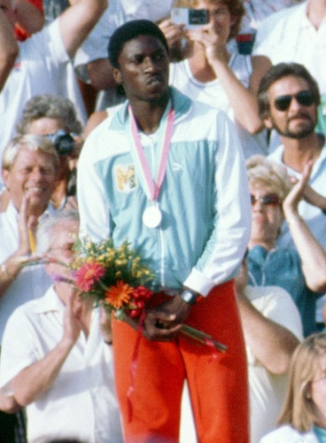Gabriel Tiacoh won silver in the men's 400m at the 1984 Olympics, behind USA's Alonzo Babers. (Photo Credit: Wikipedia).