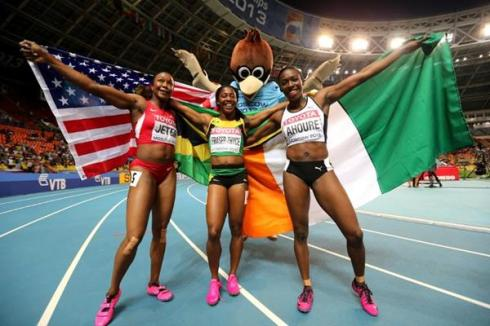 Murielle Ahoure celebrates her 2013 World Championships Silver medal along with 100m champion, Shelly-Ann Fraser-Pryce and bronze medallist, Carmelita Jeter of the US.  (Photo Credit: Getty Images).
