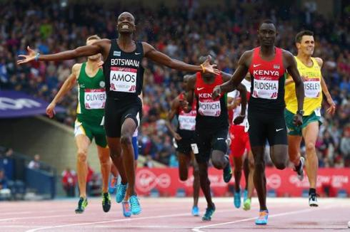 Nijel Amos celebrates his historic win over David Rudisha at the 2014 Commonwealth Games in Glasgow. (Photo Credit: Cameron Spencer/Getty Images Europe)