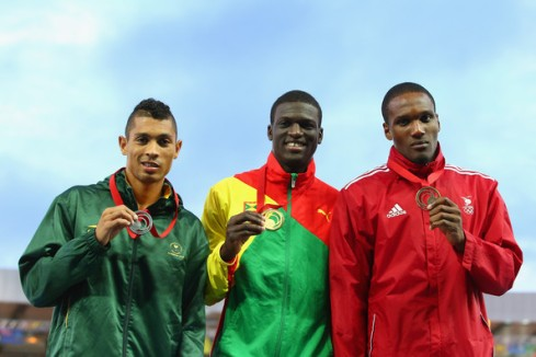Silver medallist Wayde van Niekerk, gold medallist Kirani James and bronze medallist Lalonde Gordon pose with their medals. (Photo Credit: Mark Kolbe/Getty Images Europe)